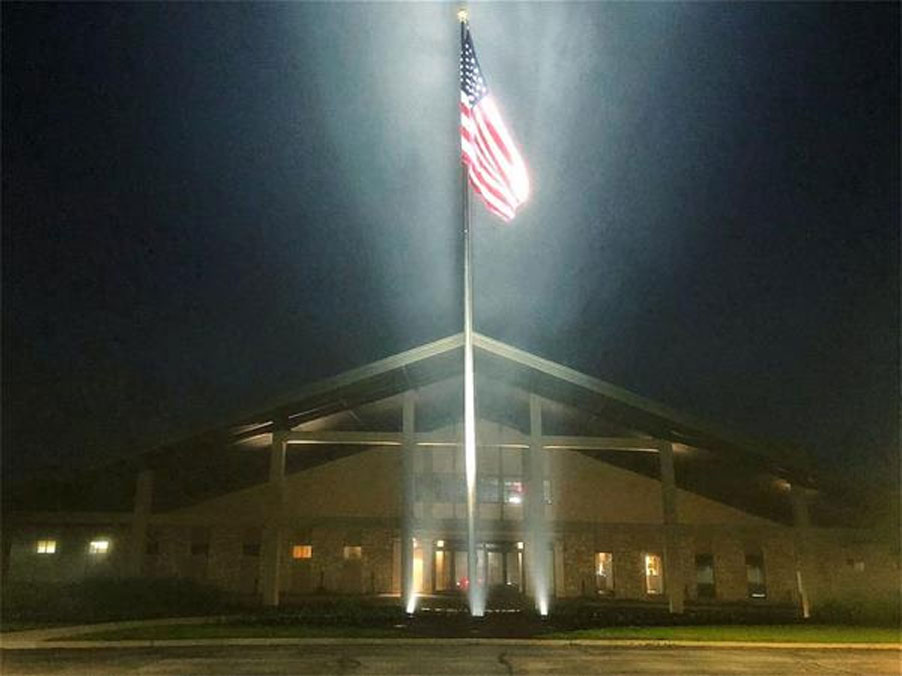 Valley Brook Country Club in Canonsburg, PA with night led lights shining up at flag for Memorial Day